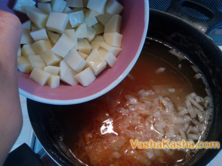 potatoes, carrots and onions in a saucepan