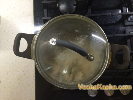 saucepan with lid on the stove