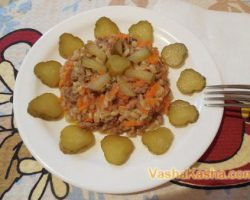Recipe barley with minced meat in a pan